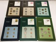 World – lot of various coins 'Coin Sets of all Nations' (29 countries) + stamps.