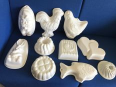 10 various glazed white pudding moulds NL