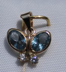 14 kt yellow gold butterfly pendant, set with topaz and zirconia, measurements: 10 x 11 mm