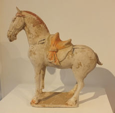 An impressive large white pottery figure of a horse, with TL test - H. 34 cm.