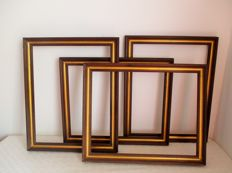 Four wooden gold plated frames