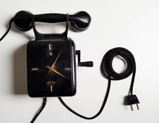 Bakelite telephone with rotating crank in the shape of a clock - Netherlands-1st half 20th century