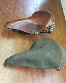 Beautiful brown Brooks B66 Champion saddle and a very old Simson saddle.