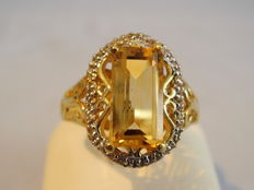 Ring with natural citrine 3.5ct and white topazes 0.10ct.