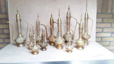 Collection of 11 copper jugs.
