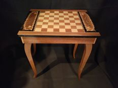 Beautiful chess table with music box and chess pieces.