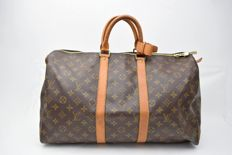 6d48756957 Louis Vuitton – Keepall 45 Travel bag with tag/name and handle holder