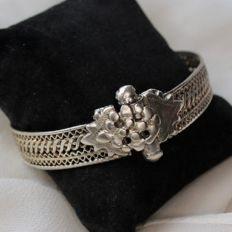 About 1900/1910 handcrafted silver bracelet with woven and braided elements through the band and antique clasp.