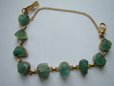 Indonesian gold bracelet with rough emerald.