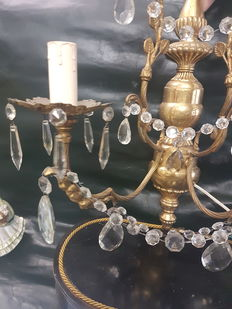 A chandelier and a pair of sconces in gilded bronze and crystal glass - second half of the 20th century