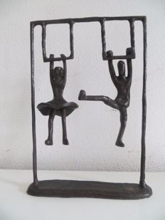 Boy and girl playing on a rack