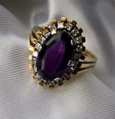 Handcrafted solid ring 585 gold with beautiful faceted natural Amethyst in dark color approx 6.5ct. and 20 natural diamonds H /VS; 6,87Ct total.