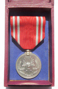 Japanese Red Cross medal of honour in rare burgundy red box. Beginning of the 20th century.