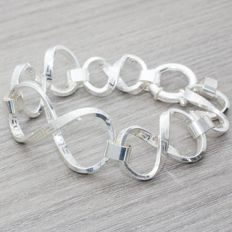925/1,000 sterling silver bracelet composed of Rolo links, in Italian design. Length: 20.50 cm.