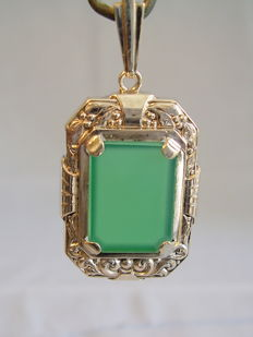 A silver pendant with a transparent green agate