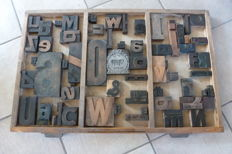 Old letter tray from a typecase of a printing company, with approx. 65 original large block letters, early 20th century, the Netherlands