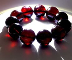 Amber bracelet cherry colour of  large round beads 19.5 mm in diameter, 46.8 gr.