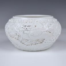Bowl – Chinese porcelain with decoration of dragon in relief – China – late 20th century