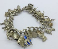 A heavy antique  silver and white metal charm bracelet, 85.5g