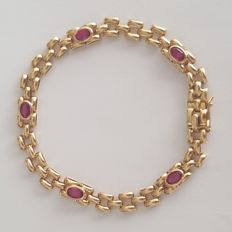 18 kt gold bracelet with red coloured stones – Length: 18 cm