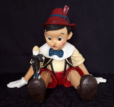 Vintage hand-painted figurine of Pinocchio with Jiminy Cricket