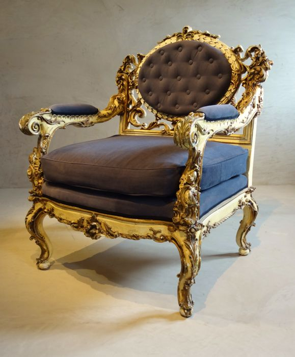 A carved, polychrome and gilded Louis XV style arm chair - presumably France, late 19th century