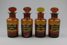 Lot of 4 large antique glass Pharmacists jars with labels- one with toxic label, circa 1900.