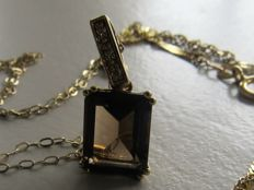 Gold Art Deco-style pendant with natural smoky quartz and 3 diamonds, gold necklace and gold bracelet.