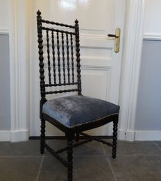 Graceful chair in black patent with blue velour upholstery, first half of 20th century