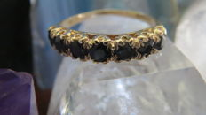 Gold eternity ring, set with 7 natural blue sapphires Faceted