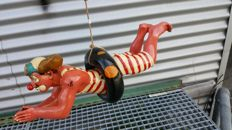 A very nice sculpture of a swimming clown
