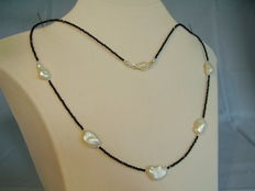 Designer necklace made of natural faceted black spinels and white Keshi pearls