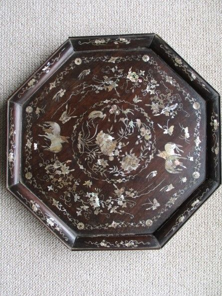 Octagonal decorative platter with fine mother-of-pearl marquetry inlay.