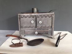 Rare - antique cast iron, 19th century coal stove, toy furnace with frying pan, waffle iron and ironing board.