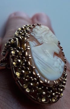 Nice a 14k gold ring set with a cameo carved on a shell–expert taxation
