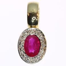 Oval shaped ruby and diamond yellow gold pendant