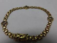Gold (18 kt) bracelet with emeralds and zirconias. 19 cm.