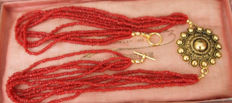 Five-rowed necklace of red coral.