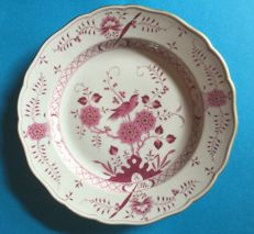 A Meissen cabinet plate with bird and gold trim