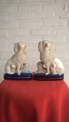 Two antique Staffordshire dogs, earthenware, 19th century