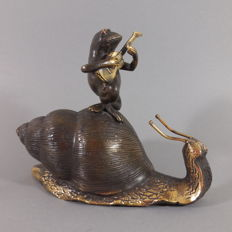 Curious bronze sculpture of a snail with frog