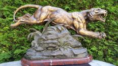 Louis Albert Carvin (1875-1951) - large patinated zamak sculpture of a leaping tiger on marble base - early 20th century