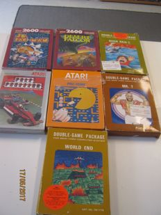 7 boxed Atari 2600 games.  Complete with manuals