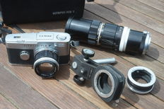 Olympus Pen FT with amongst others a 40 mm f/1.4, 100-200 mm and many accessories, see description and photoraphs!