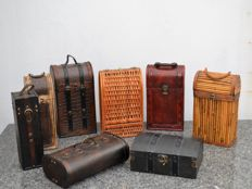 8 wooden/wicker (wine) cases finished with leather and brass elements.