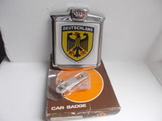 vintage chrome DEUTSCHLAND  car badge un -used still in box with fixings 1970