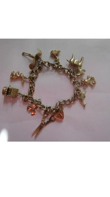 Two pairs of vintage 9ct gold charm bracelets 14.3 g and 11.2 grams both 7inch long