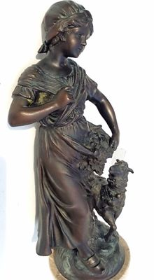 Metal statue – Woman with flowers and sheep – signed: F. Mou.....Belgium – 1st half of 20th century.