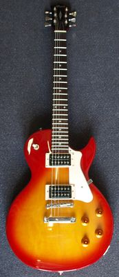 New Cort Cherry Red Sunburst Les Paul model with cover and tuner