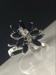 White gold cocktail ring with marquise cut sapphires and diamonds